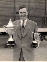 PWA443 1950s Jack Jeffery with trophies won for his Dorset Horn sheep
